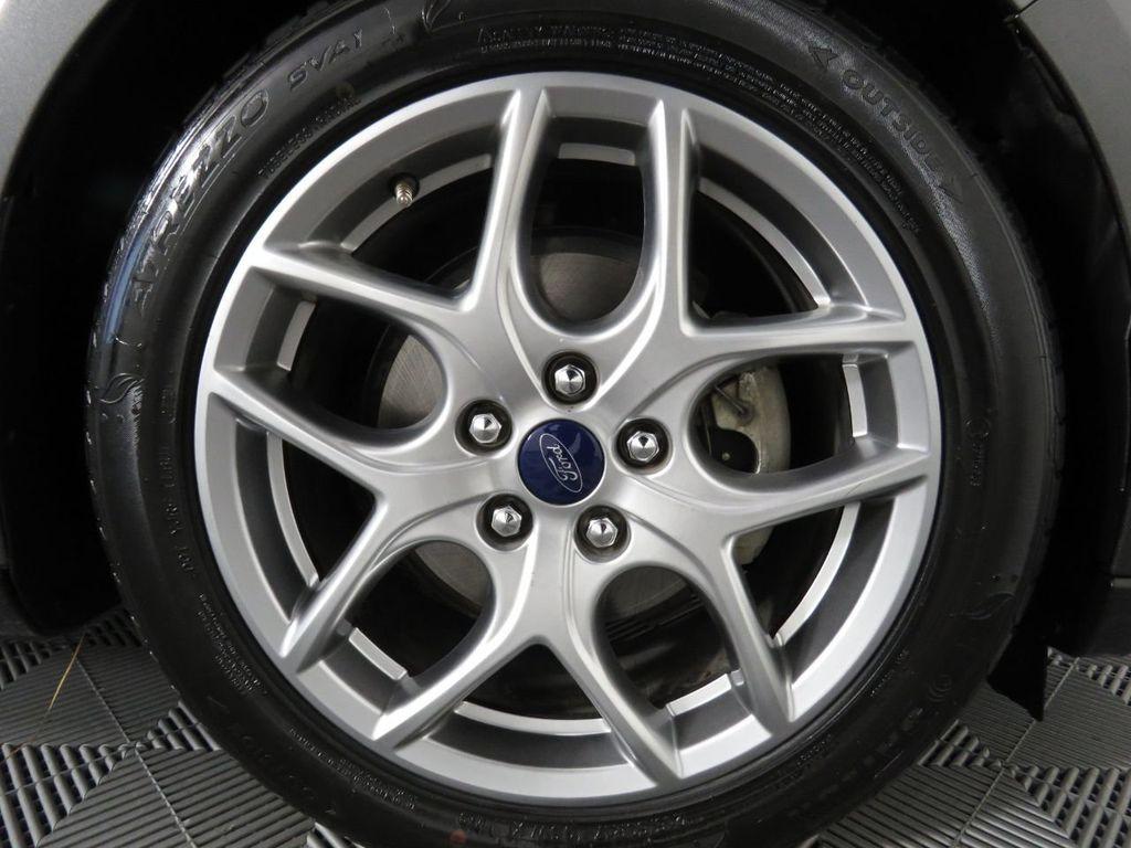 Pre-Owned 2015 Ford Focus 4dr Sedan SE