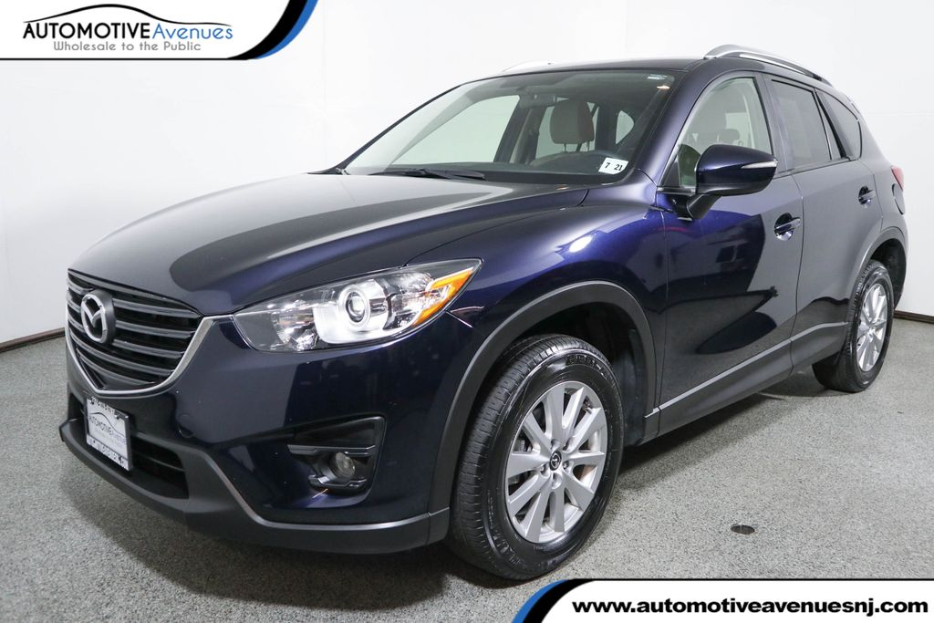 Pre-Owned 2016 Mazda CX-5 2016.5 AWD 4dr Touring with Bose/Moonroof Package & Navigation