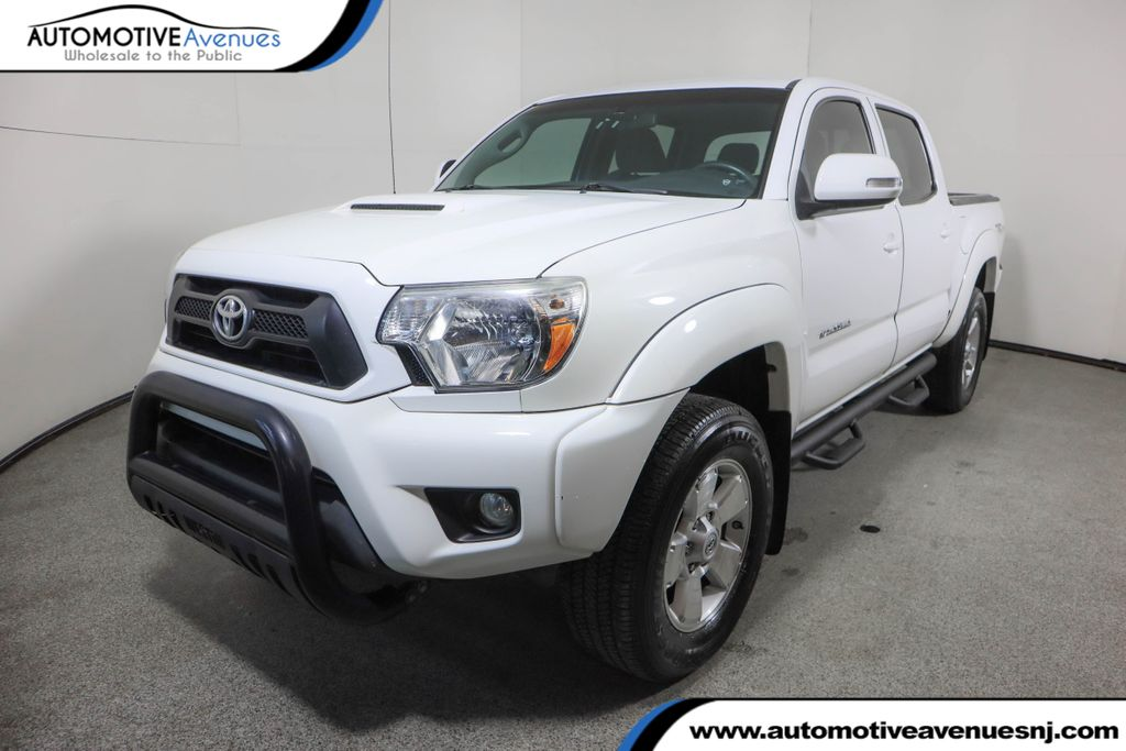 Pre-Owned 2015 Toyota Tacoma 4WD Double Cab V6 TRD Sport w/ Extra Value Package & Navigation