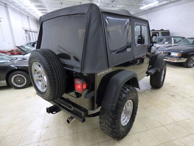 1992 Jeep Wrangler REBUILT 4BT CUMMINS DIESEL 4 INCH SUSPENSION LIFT 35 INCH TIRES - Click to see full-size photo viewer