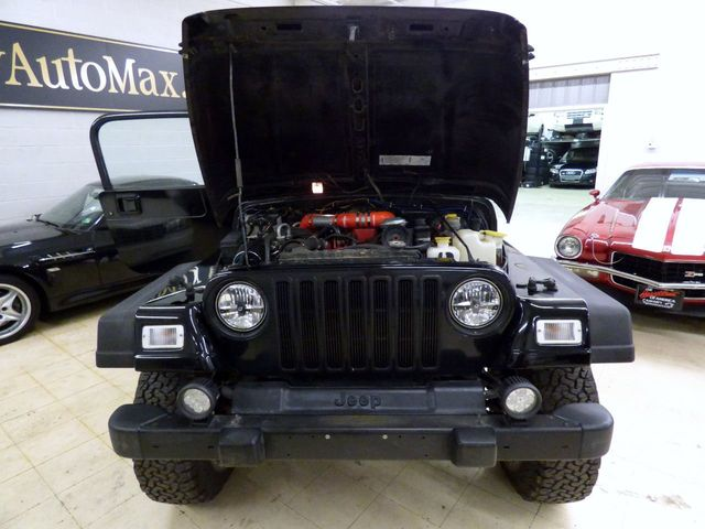 1999 Jeep Wrangler 4BT CUMMINS TURBO INTERCOOLED DIESEL NEW SUSPENSION 3 INCH LIFT  - Click to see full-size photo viewer