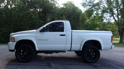 "2003 Dodge Ram 1500 2dr Reg Cab 120.5"" WB 4WD SLT - Click to see full-size photo viewer"