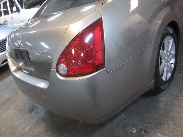 2004 nissan maxima brake warning light
