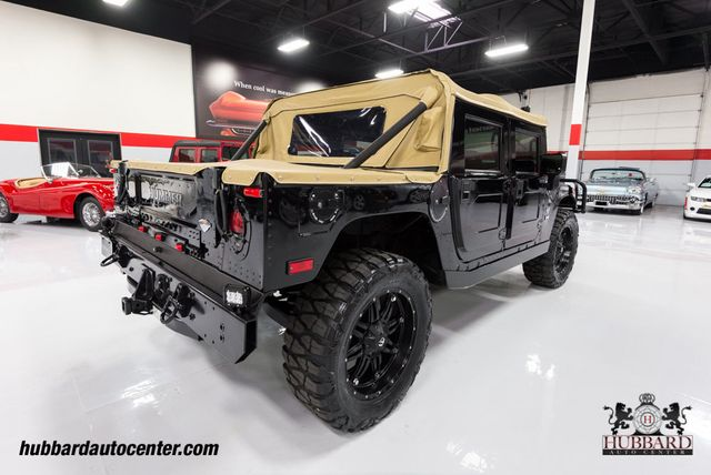 "2006 HUMMER H1 Fully Custom Alpha, Nav, 22"" Wheels, 37"" Tires, LED Lights!!! - Click to see full-size photo viewer"