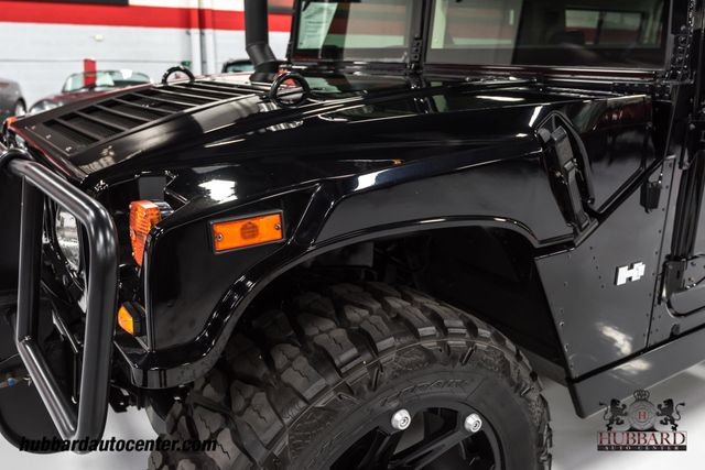2006 HUMMER H1 Rare and hard to find black Alpha wagon - Click to see full-size photo viewer