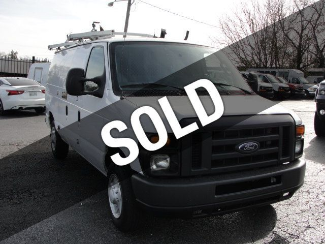 2009 Ford E-150 FORD, CARGO VAN, E-150, LADDER RACK, BINS, V8, AUTOMATIC - 16835965 - 0