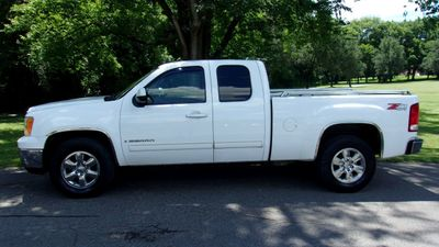 "2009 GMC Sierra 1500 4WD Ext Cab 143.5"" SLT - Click to see full-size photo viewer"