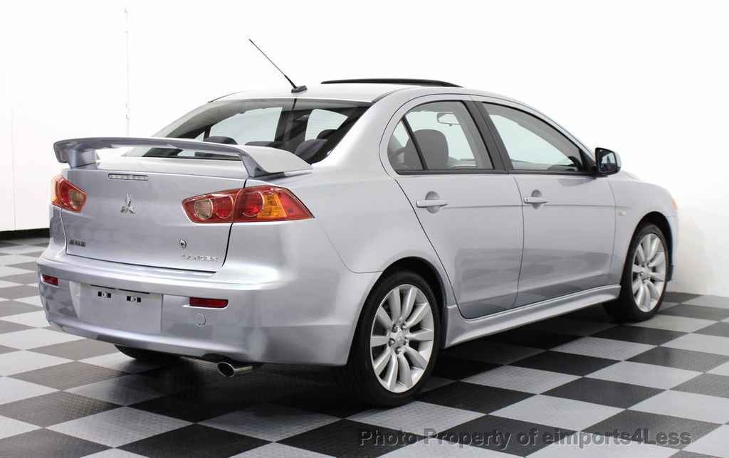 2009 used mitsubishi lancer gts sedan with navigation at. Black Bedroom Furniture Sets. Home Design Ideas