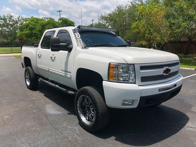 "2010 Chevrolet Silverado 1500 4WD Crew Cab 143.5"" LT - Click to see full-size photo viewer"