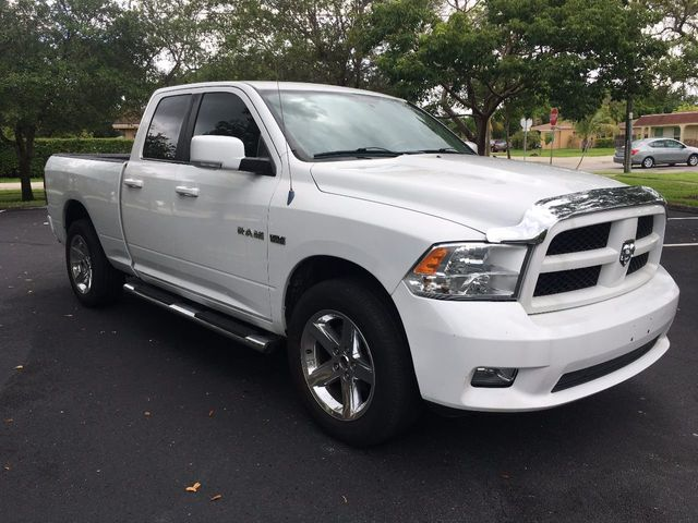 "2010 Dodge Ram 1500 4WD Quad Cab 140.5"" SLT - Click to see full-size photo viewer"