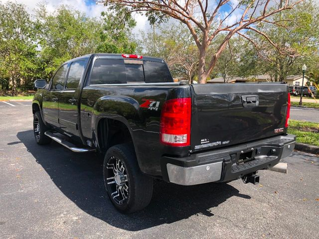 "2010 GMC Sierra 2500HD 4WD Crew Cab 153"" SLT - Click to see full-size photo viewer"