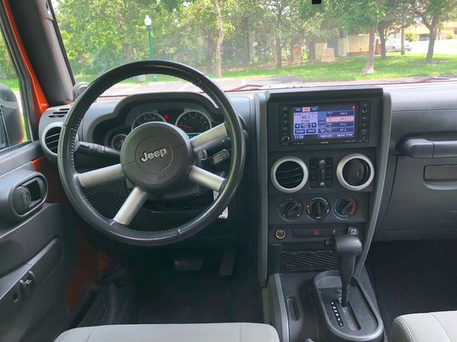2010 Jeep Wrangler Unlimited RWD 4dr Sahara - Click to see full-size photo viewer