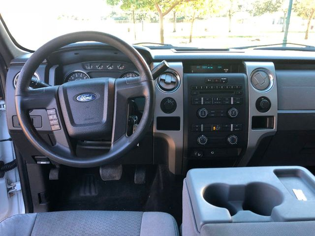 "2011 Ford F-150 4WD SuperCab 145"" XLT - Click to see full-size photo viewer"