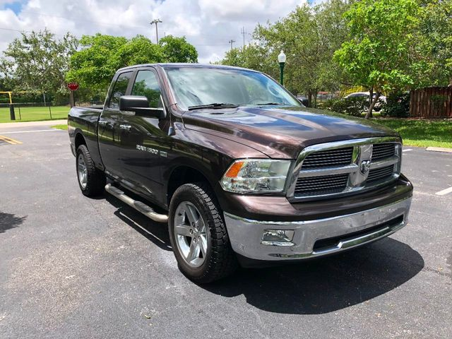 "2011 Ram 1500 4WD Quad Cab 140.5"" Big Horn - Click to see full-size photo viewer"