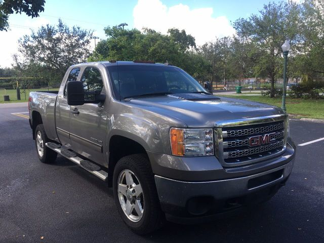 "2012 GMC Sierra 2500HD 4WD Ext Cab 144.2"" SLE - Click to see full-size photo viewer"