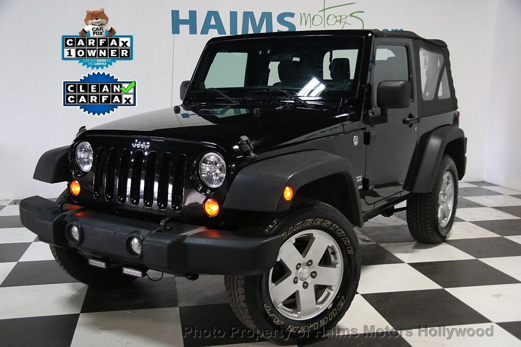 2012 used jeep wrangler 4wd 2dr freedom edition at haims motors serving fort lauderdale. Black Bedroom Furniture Sets. Home Design Ideas