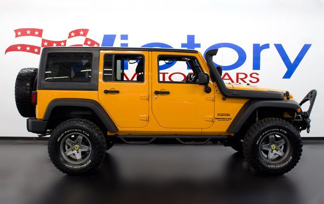 2012 Jeep Wrangler Unlimited Sport - Click to see full-size photo viewer