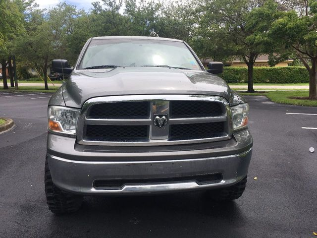 "2012 Ram 1500 4WD Quad Cab 140.5"" SLT - Click to see full-size photo viewer"