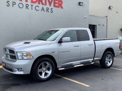 "2012 Ram 1500 4WD Quad Cab 140.5"" Sport - Click to see full-size photo viewer"