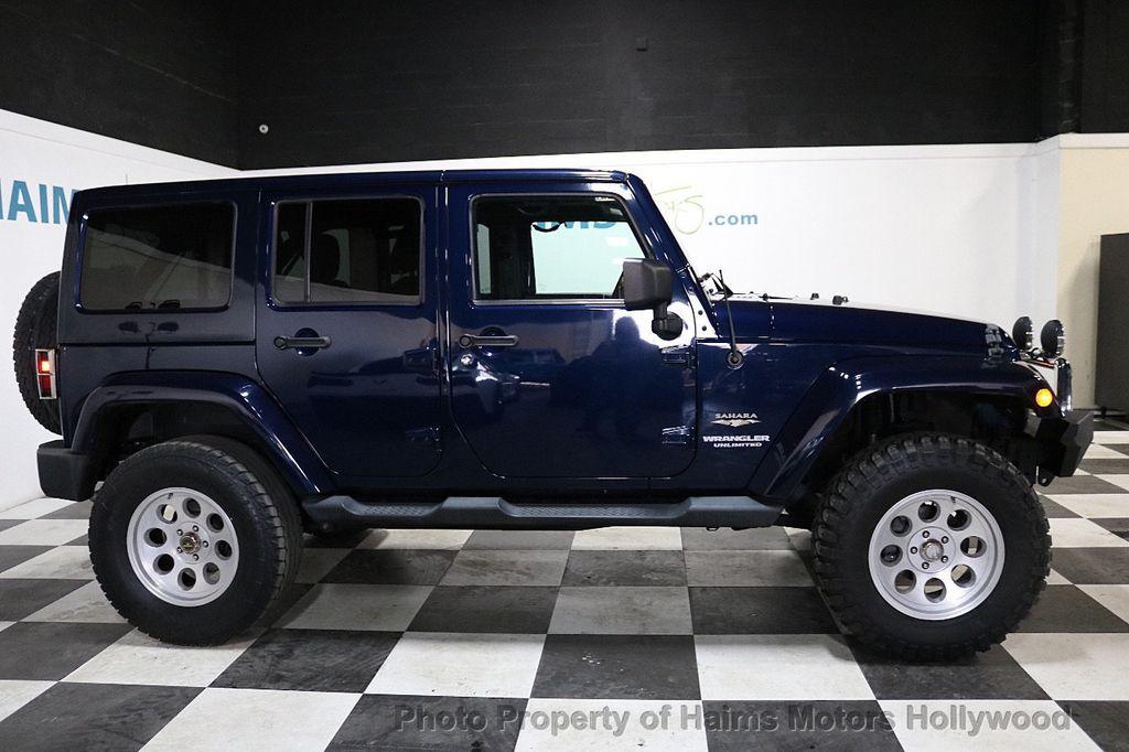2013 Jeep Wrangler Unlimited 4WD 4dr Sahara - 18575378 - 16