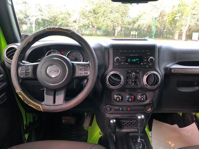 2013 Jeep Wrangler Unlimited 4WD 4dr Sport - Click to see full-size photo viewer