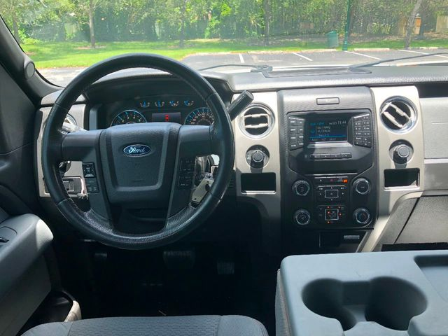 "2014 Ford F-150 4WD SuperCrew 145"" XLT - Click to see full-size photo viewer"