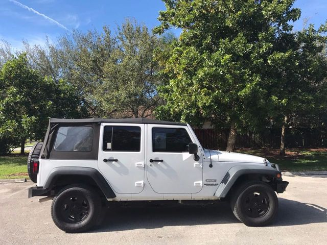 2014 Jeep Wrangler Unlimited 4WD 4dr Sport - Click to see full-size photo viewer