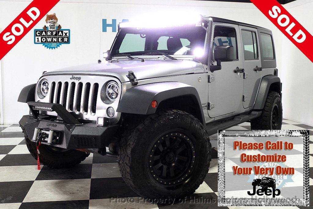 2014 Jeep Wrangler Unlimited 4WD 4dr Willys Wheeler - 17810296 - 0