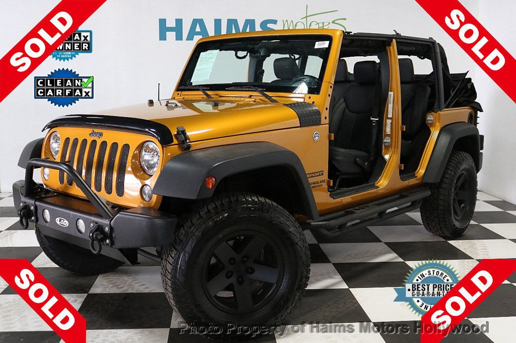 2014 Jeep Wrangler Unlimited 4WD 4dr Willys Wheeler - 18688932 - 0