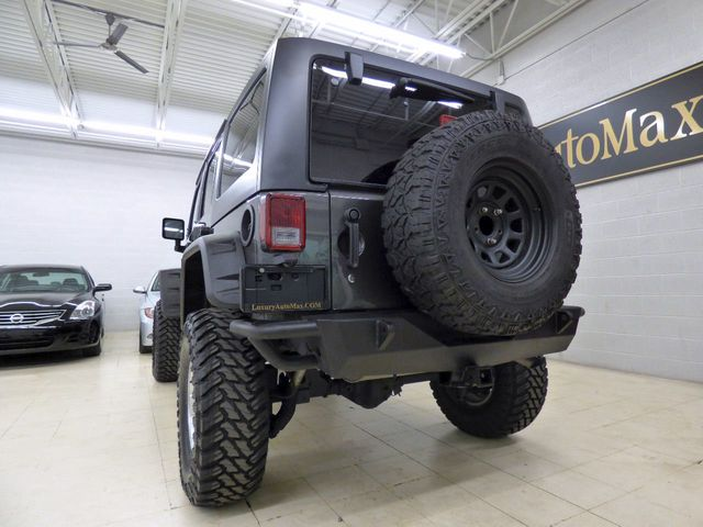 2014 Jeep Wrangler Unlimited Sport - Click to see full-size photo viewer