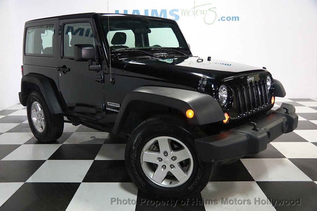 2016 used jeep wrangler 4wd 2dr sport at haims motors serving fort lauderdale hollywood miami. Black Bedroom Furniture Sets. Home Design Ideas