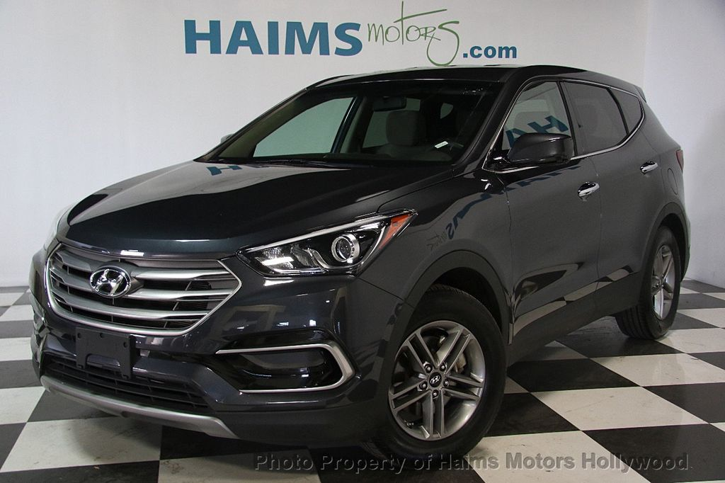 showroom on santa black sante with roads engaged abs luxury assist fe sport en breaking spacious wet suv canada img hyundai safety